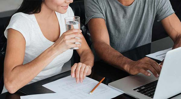 Couple filling out paperwork