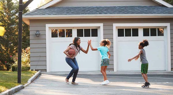 Kids playing basketball with mom