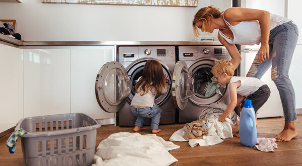 Kids helping mom with laundry